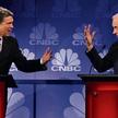 Podczas debaty w telewizji CNBC Rick Perry (z lewej) usiłował przekonać Rona Paula, że wie, jak ogra