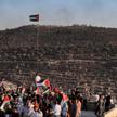 Palestyńczycy protestują przeciw izraelskiemu osiedlu w pobliżu miasta Nablus na Zachodnim Brzegu, f