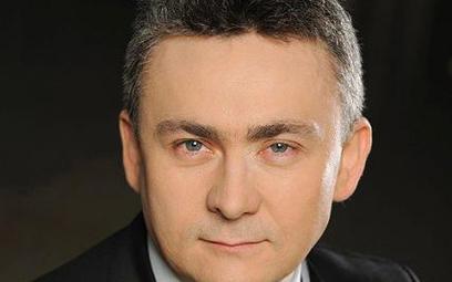 Jarosław Koziński, partner EY