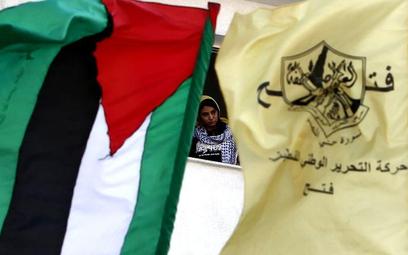 Flaga Palestyny obok flagi partii Fatah